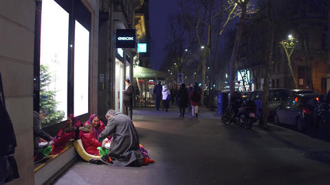 PARIS, FRANCE - DECEMBER, 31, 2016. Local man giving present to immigrant little Footage