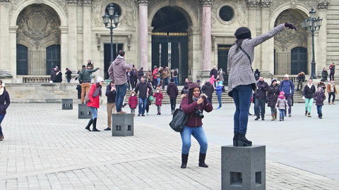 PARIS, FRANCE - DECEMBER, 31, 2016. Tourists posing and making photos near the Footage