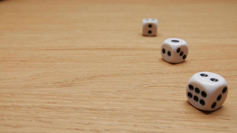 Dice rolling on the table. Close-up Footage