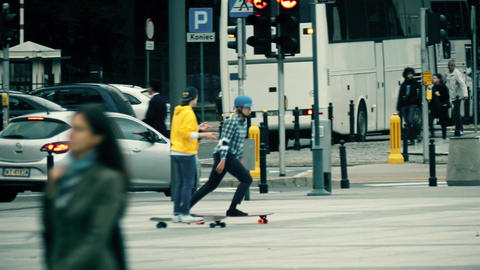 WARSAW, POLAND - SEPTEMBER 14, 2017. Female teenagers riding skateboards on the Footage