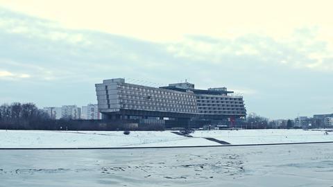 KRAKOW, POLAND - JANUARY, 14, 2017 Forum Hotel and river Vistula embankment in Foto