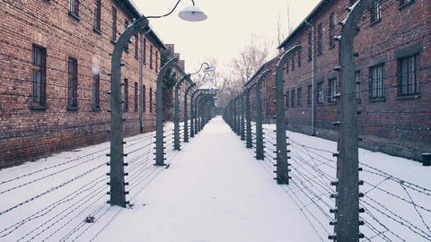 Barbed wire fences of concentration camp in falling snow Footage
