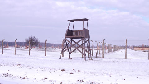 Guard tower and barbed wire fence of a concentration camp in winter Footage