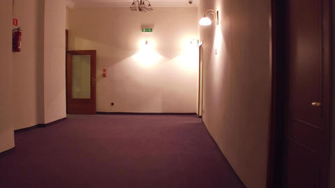 Walk through hotel corridor to staircase Footage