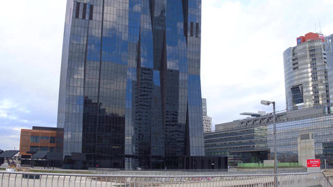 VIENNA, AUSTRIA - DECEMBER, 24, 2016. Hyperlapse of Donau City Tower reflecting Footage