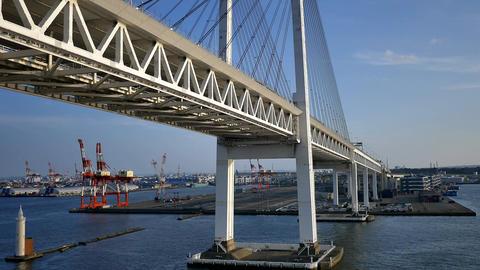 shot of cruise passing under yokohama bridge Archivo