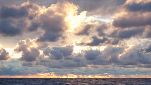 Clouds over the sea at sunset Footage