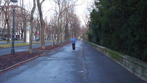 VIENNA, AUSTRIA - DECEMBER, 25 Steadicam shot of a senior male runner on a Footage