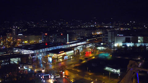 VIENNA, AUSTRIA - DECEMBER, 24 Illuminated urban railroad station and moving Footage