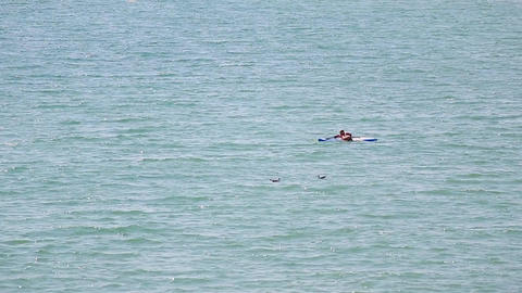 woman doing paddle boarding on the sea Archivo