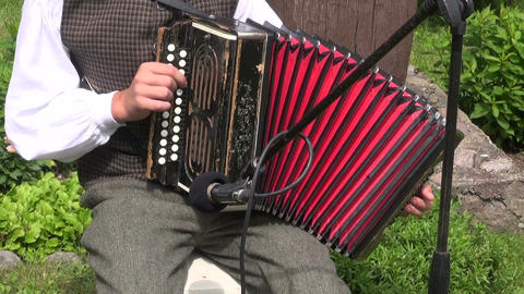 lithuanian musician play folk country music with accordion in village Filmmaterial