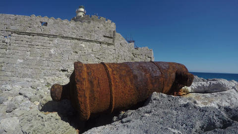 Old rusty medieval cannon near Rhodes town port fort. Rhodes island, Greece Footage