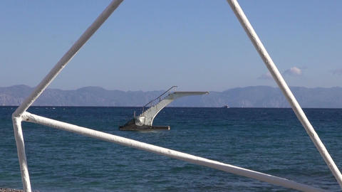 diving platform on Aegean sea and resort beach in Rhodes, Greece Filmmaterial