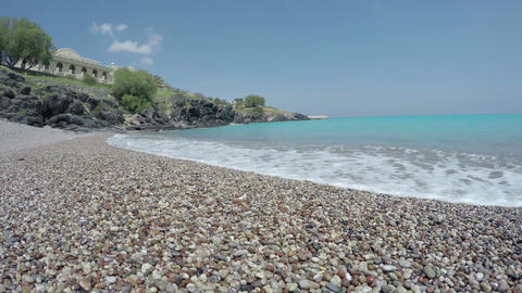 beautiful pebbles stone beach in Lindos resort, Rhodes island, Lindos, Greece. Footage