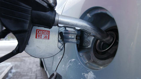 Filling car with gas fuel at station pump Footage