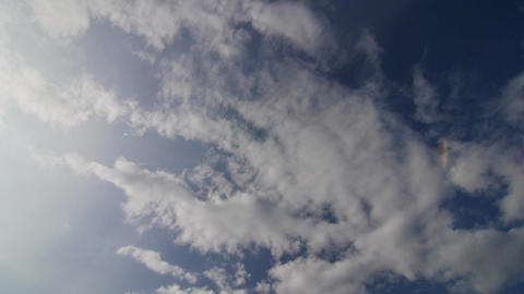 time lapse, sun shining and moving clouds Footage