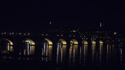 Famous Charles bridge and distant Prague castle at night Czech Republic Footage