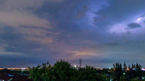 Time lapse of thunderstorm clouds with lightning at night Footage