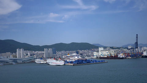 wide shot of cruise ship arriving at busan port of korea Footage