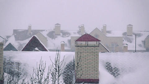 Snowstorm above residential houses in winter Footage