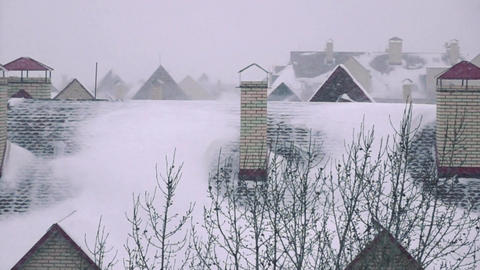 Snowstorm above sloped roofs of residential houses Footage