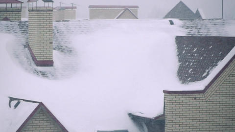 Super slow motion video of snowstorm above residential houses in winter Footage