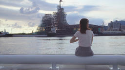 Woman looking the view with seaside Live Action