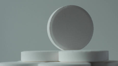 white tablets turning on a white background Footage