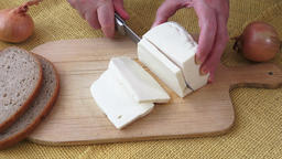 Healthy food. Goat cheese on a wooden cutting board Footage