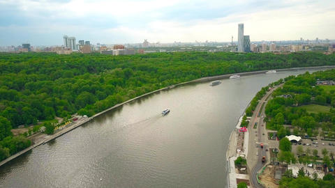 Moscow river tour boats and city skyline as seen from Vorobievy Gory Footage
