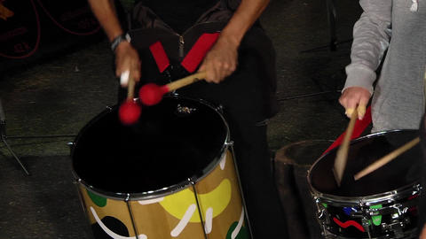 Drummers singing at a show beat the rhythm in their drums 08a Live Action