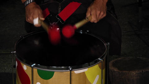 Drummers singing at a show beat the rhythm in their drums 08e Live Action