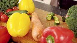 Feminine hands slicing vegetables Live Action