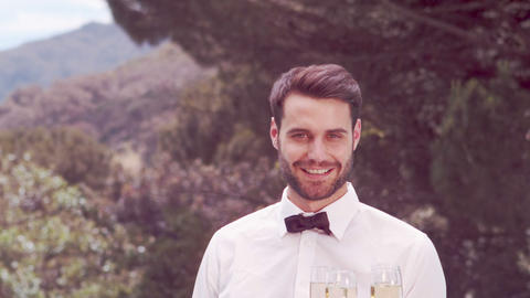 Smiling waiter holding champagne glasses Footage