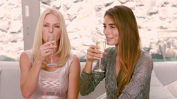 Smiling women drinking champagne glass Footage