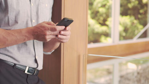 Well dressed man text messaging Footage