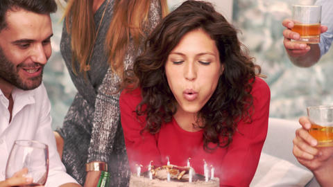 Smiling woman blowing the candles Footage