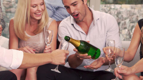Smiling man serving to friends champagne Footage