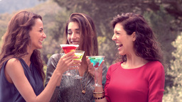 Attractive women having a drink together ビデオ