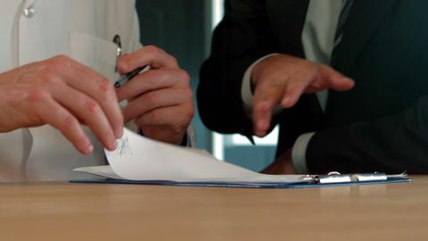 Businessman and doctor signing a agreement Footage
