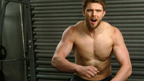 Determined man flexing muscle Footage