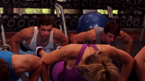 Fit group doing push ups together Footage