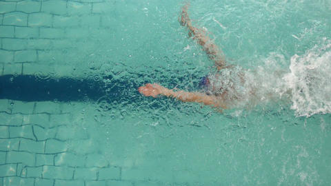 Above view of swimmer diving into pool Footage