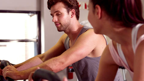 Fit people doing exercise with exercise bike Footage