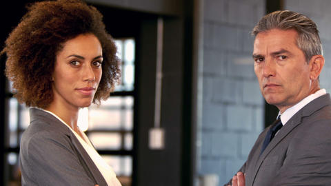 Face to face between serious businessman and businesswoman Live Action