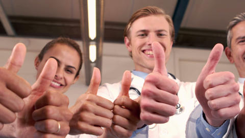 Smiling medical team with thumbs up Footage