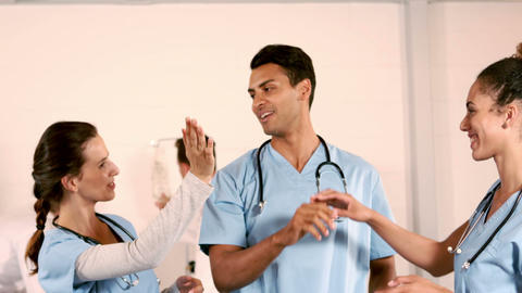 Happy medical team doing high five Footage
