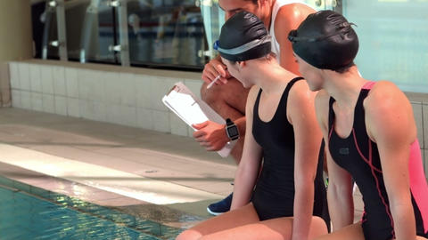 Smiling fit woman swimmers with trainer Footage