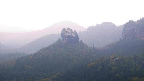 60fps timelapse. Sharp rocks hidden in valley full of heavy mist Spring misty Footage