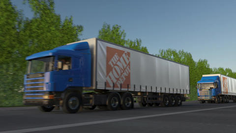 Freight semi trucks with The Home Depot logo driving along forest road, seamless Footage